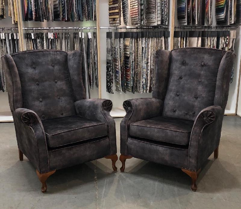 Vintage button-back wing chairs